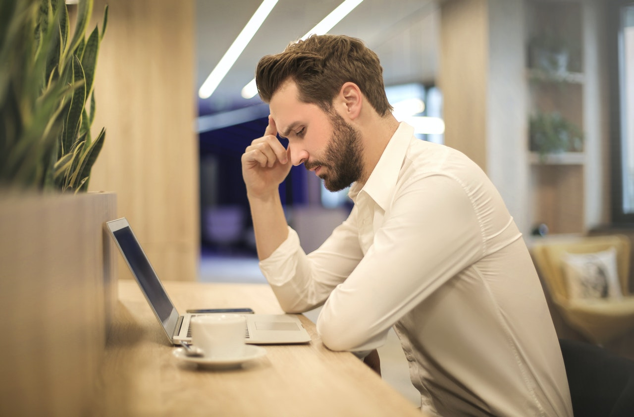 man stressed with technology